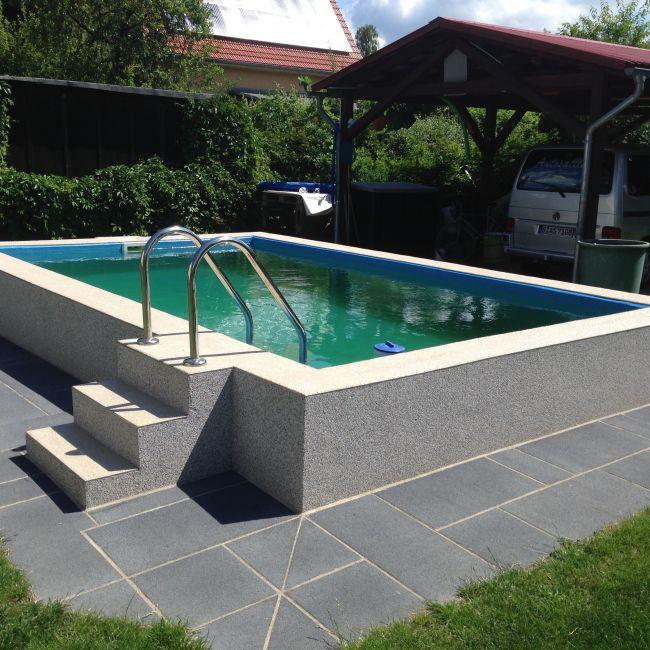 Betonpool mit GFK-Beschichtung und Steinteppichumrandung - Colorstone - fertich
